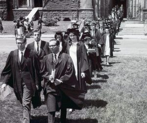 Innis students approaching Convocation Hall from the steps of University College