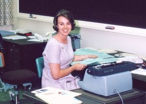 Mary Pat McMahon, Assistant to the Registrar Geoffrey Payzant, at her typewriter in the Writing Lab.