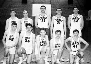 Black and white photo of the Men's Intramural Basketball Team posing wearing their uniforms.