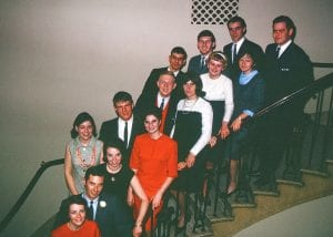 People posing on staircase
